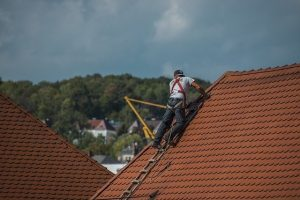 person working on a roof