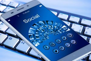 Smart Phone with social media icons and the word social